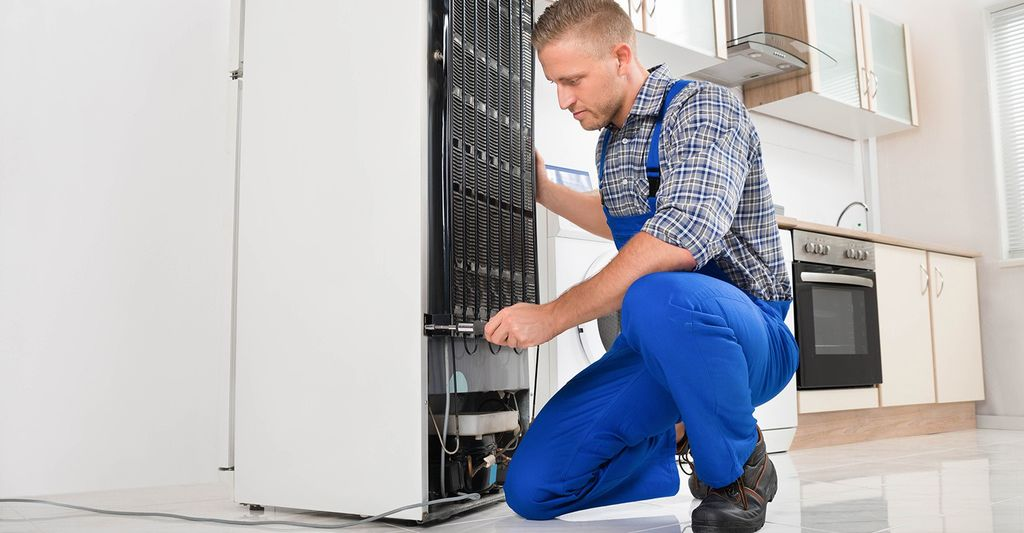 A refrigerator repair professional in Hartford, CT