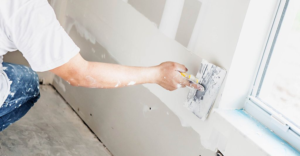 A drywall installer in Modesto, CA