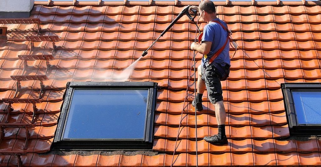 A roof cleaning professional in Gresham, OR