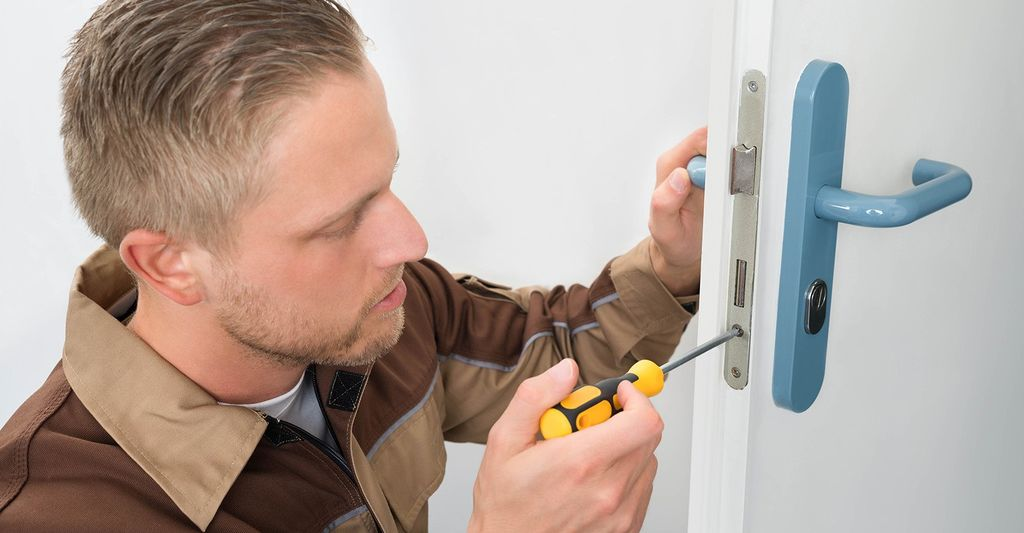 A door repair professional in Denver, CO