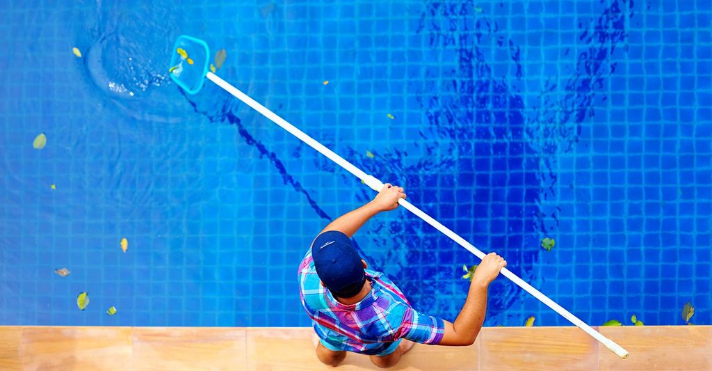 A swimming pool maintenance technician in Costa Mesa, CA