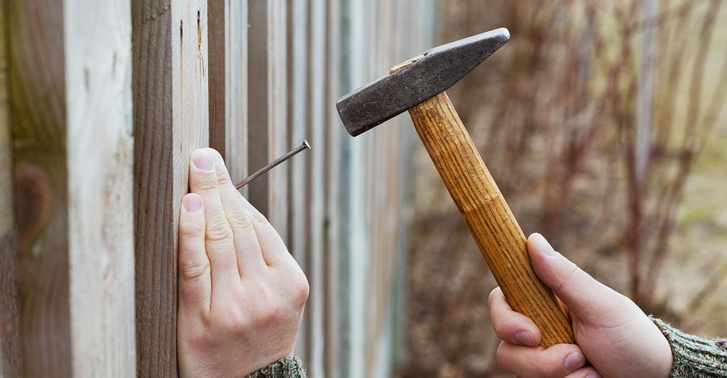 A wood fence repair professional in Riverside, CA