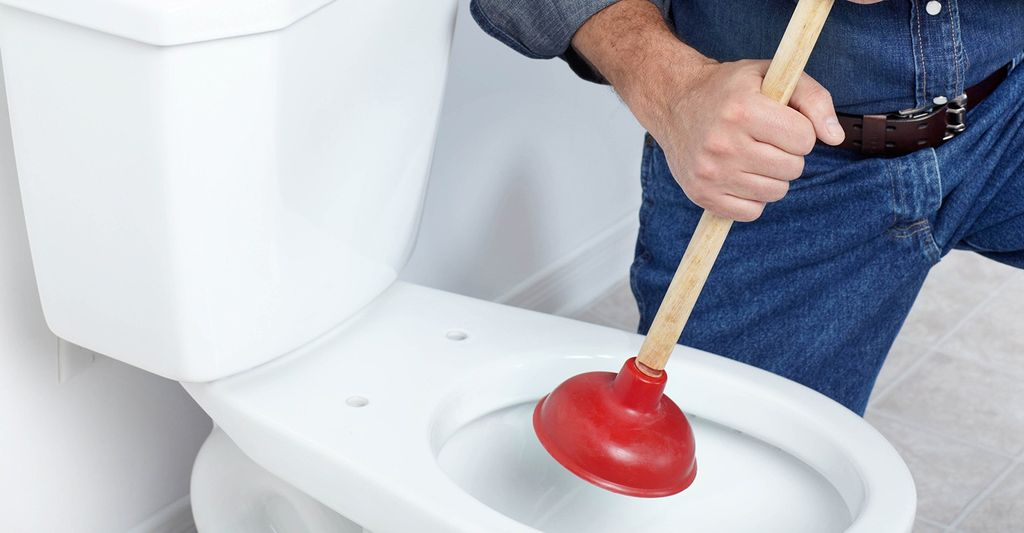 A toilet repair professional in Burnsville, MN