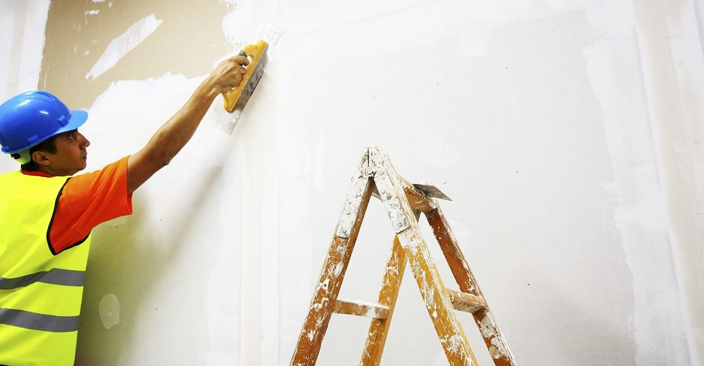 A ceiling repair professional in Gresham, OR