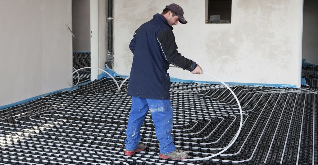 A heated floor installer in Sundance Square, TX