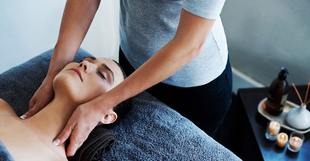 A chair massage professional in Meyerland, TX