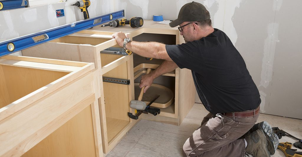 A cabinet installer in Mount Prospect, IL