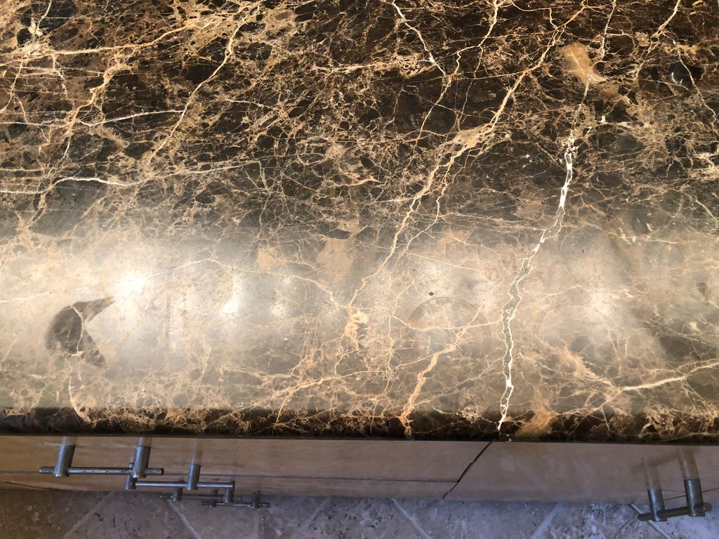 Dual sink brown marquina marble