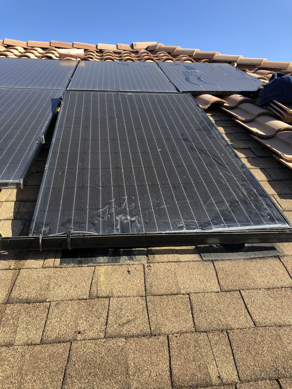 Repairing improperly installed roof under solar
