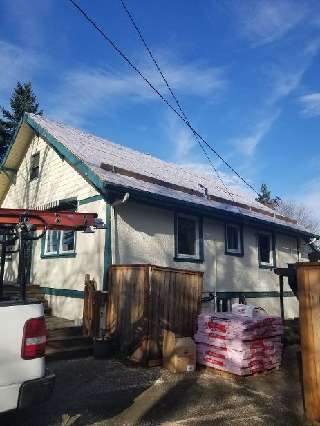 2 layer tear off, all new plywood, 50 year roof