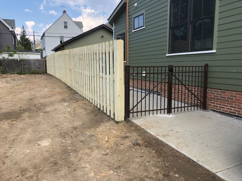 Board on boad fence with brown ornamental fence