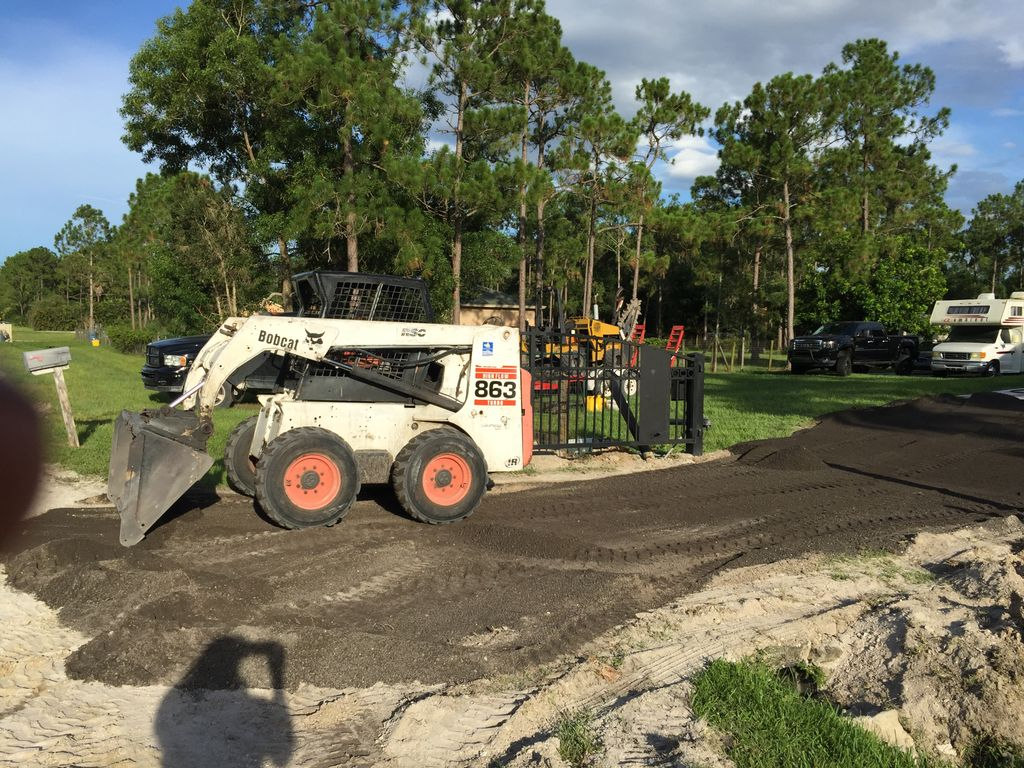 Land grading and driveway fill and fence welding