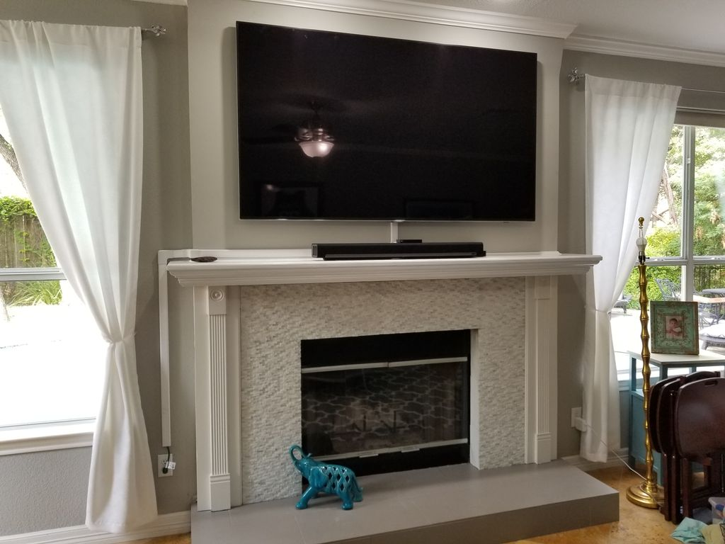 Fireplace TV mount with external wire Concealment