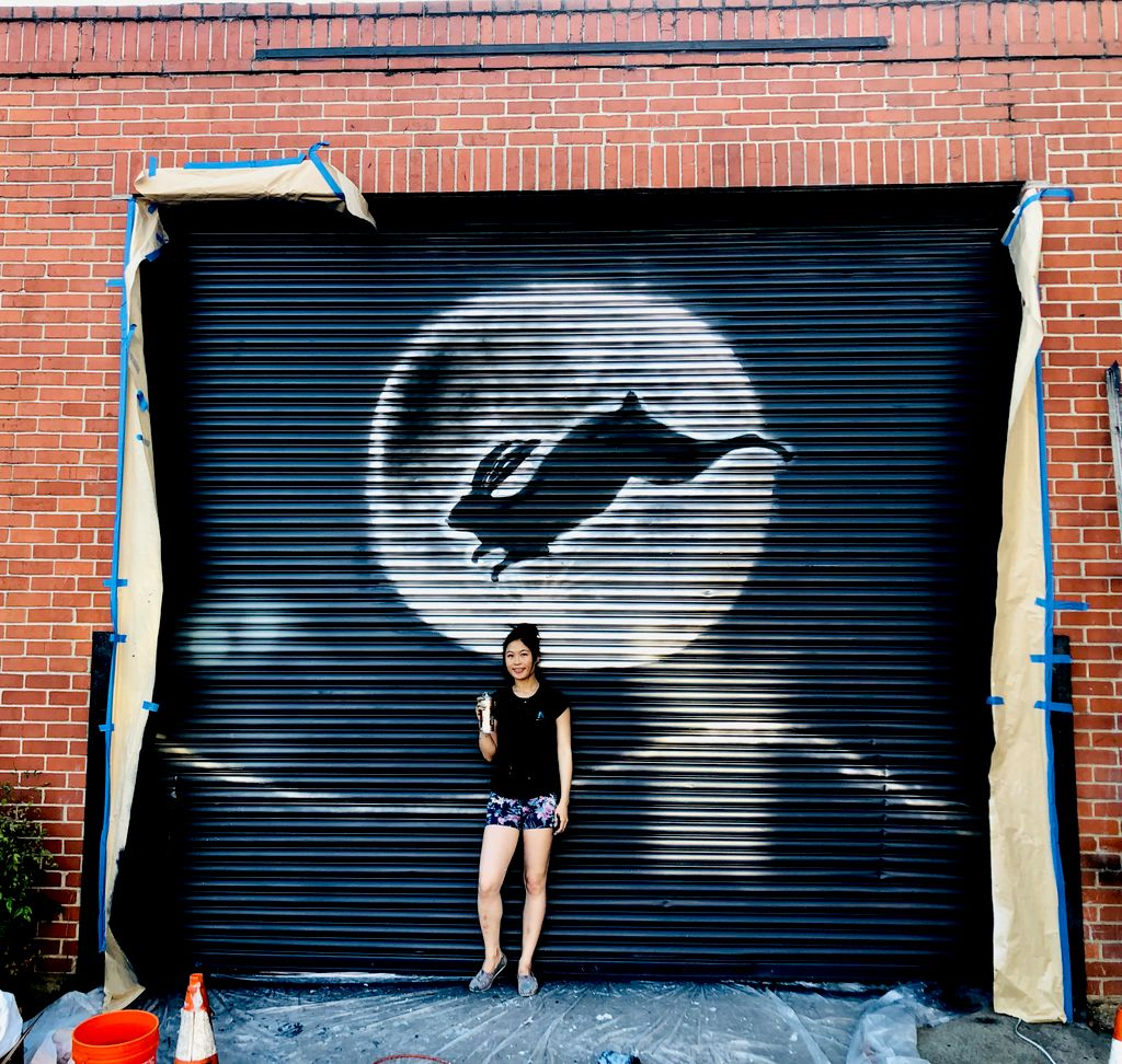 Moon and Rabbit mural for an art gallery garage door