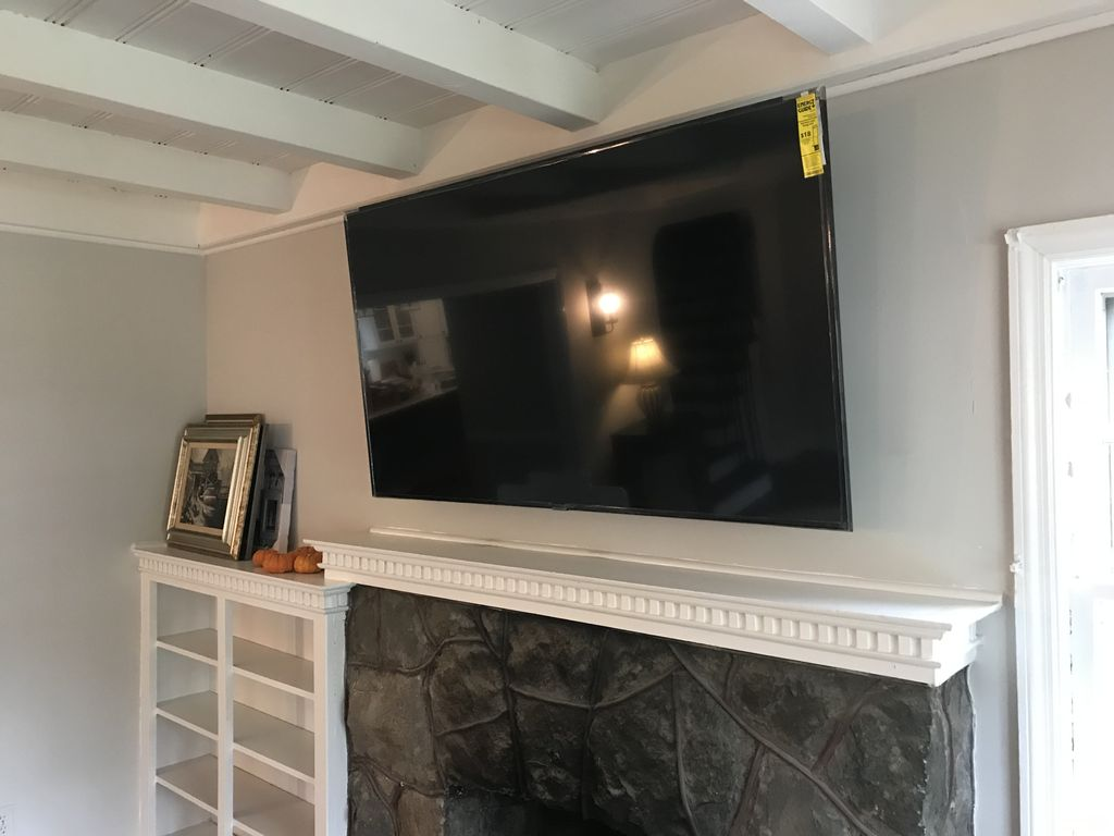 65 inch mounted over fireplace